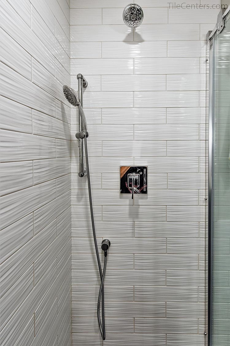 White subway tile for shower walls with chrome shower fixtures