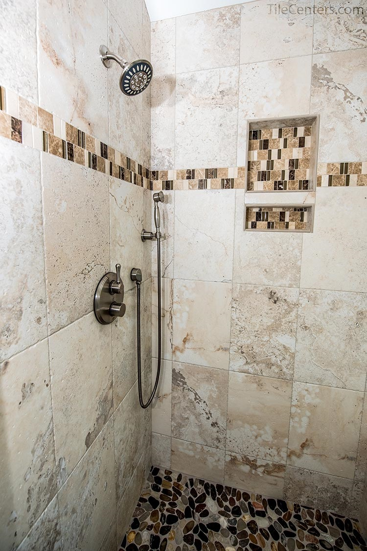 Beige Tile Shower with Stone Floor and Brushed Nickel Faucets