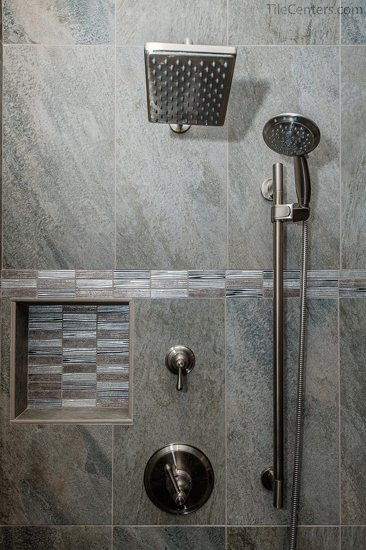 Grey Tile Shower with Brushed Nickel Faucet and Niche