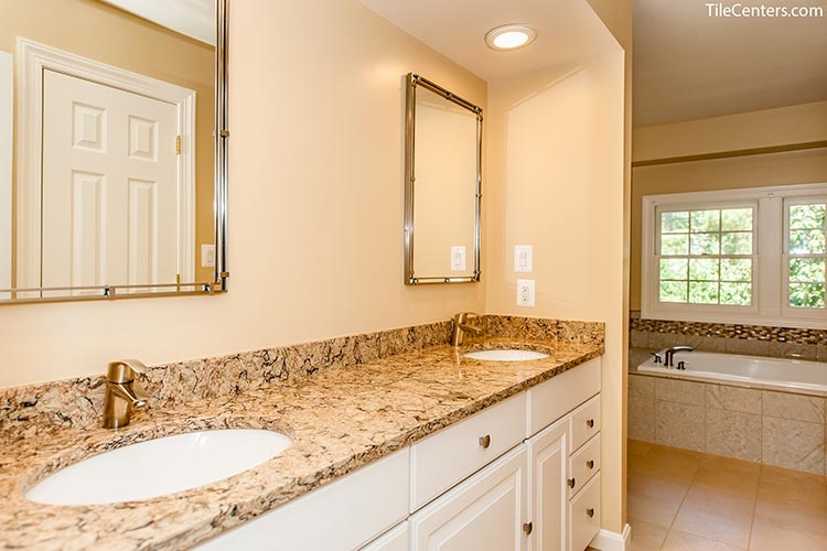 Multicolor bathroom countertop with white vanity