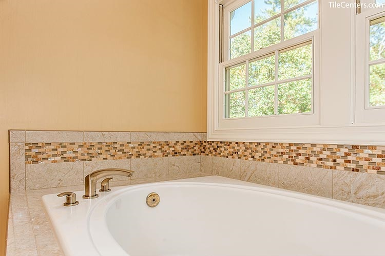 Bathtub with Beige Surround Tile and Brushed Nickel Faucet