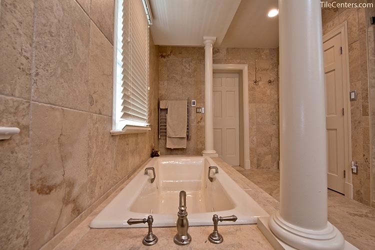 Bathtub with Beige Tile and Brushed Nickel Faucets