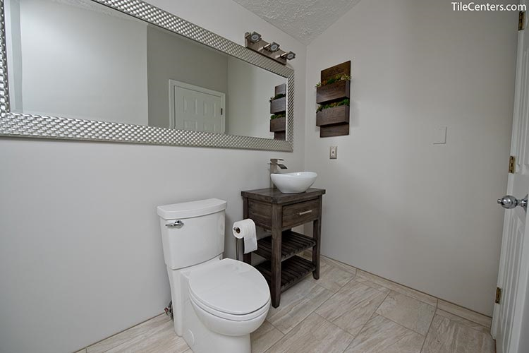 Toilet and Sink with Dark Brown Bathroom Cabinet