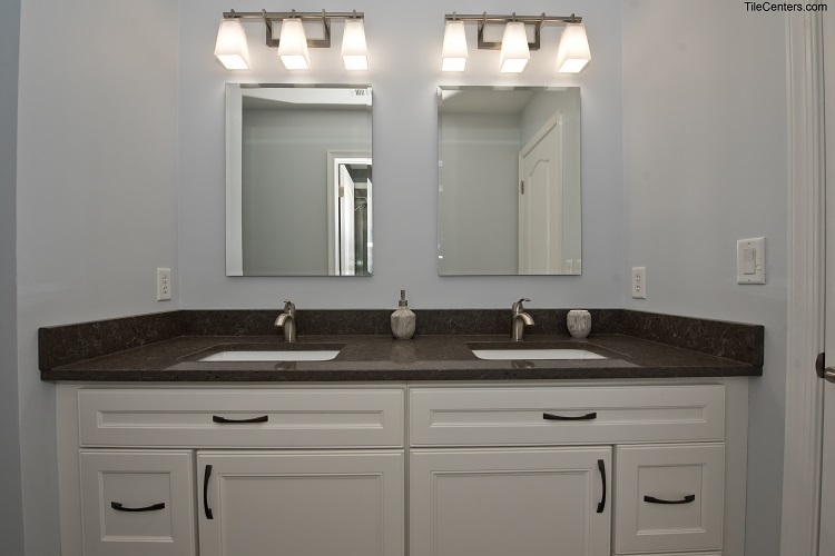 Bathroom Vanity with Black Countertop and White Cabinets